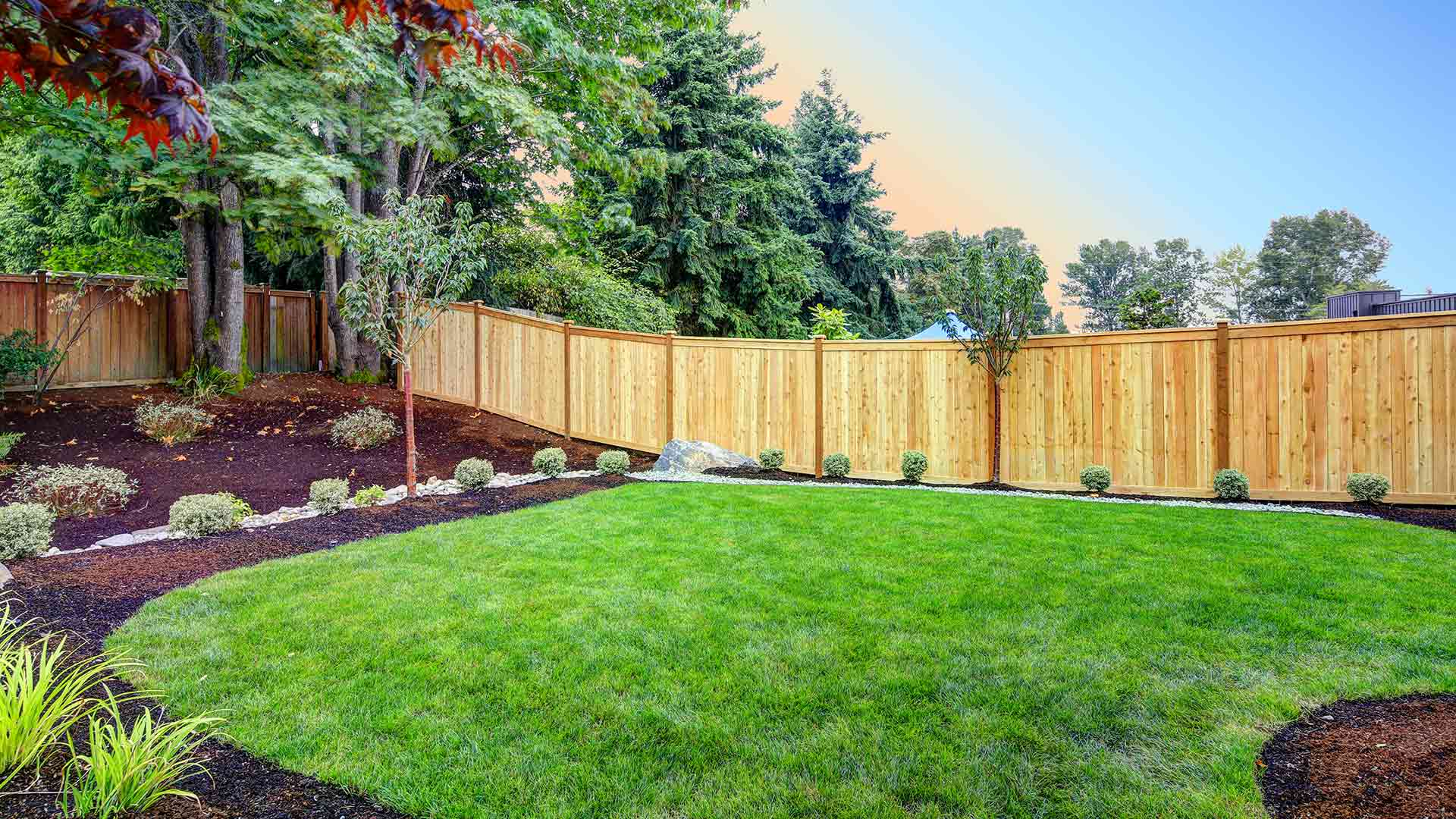Lawn and landscaping in Sauk Rapids, MN that receives routine maintenance and care services.