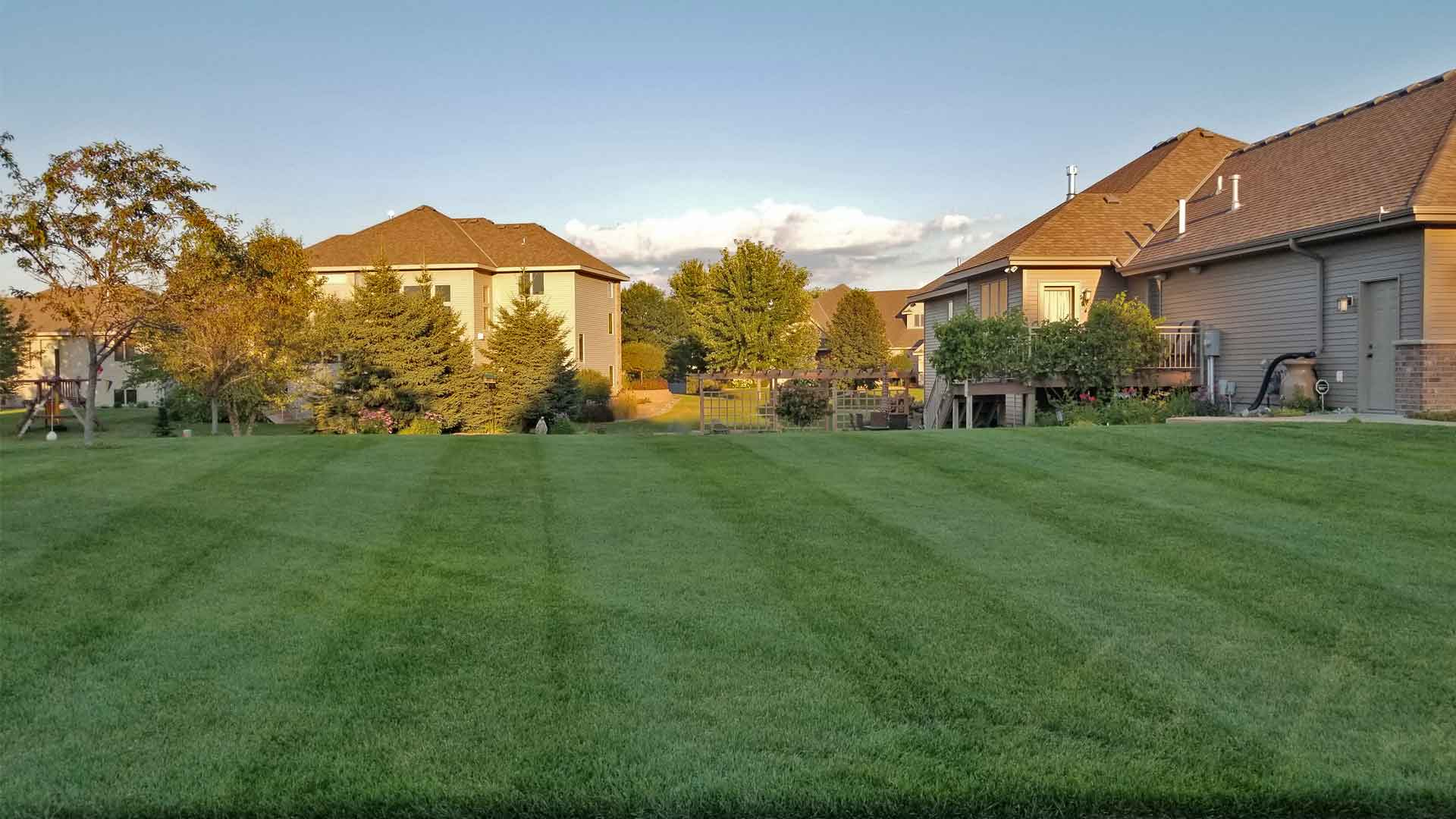 Home in Sartell, MN after professional mowing.