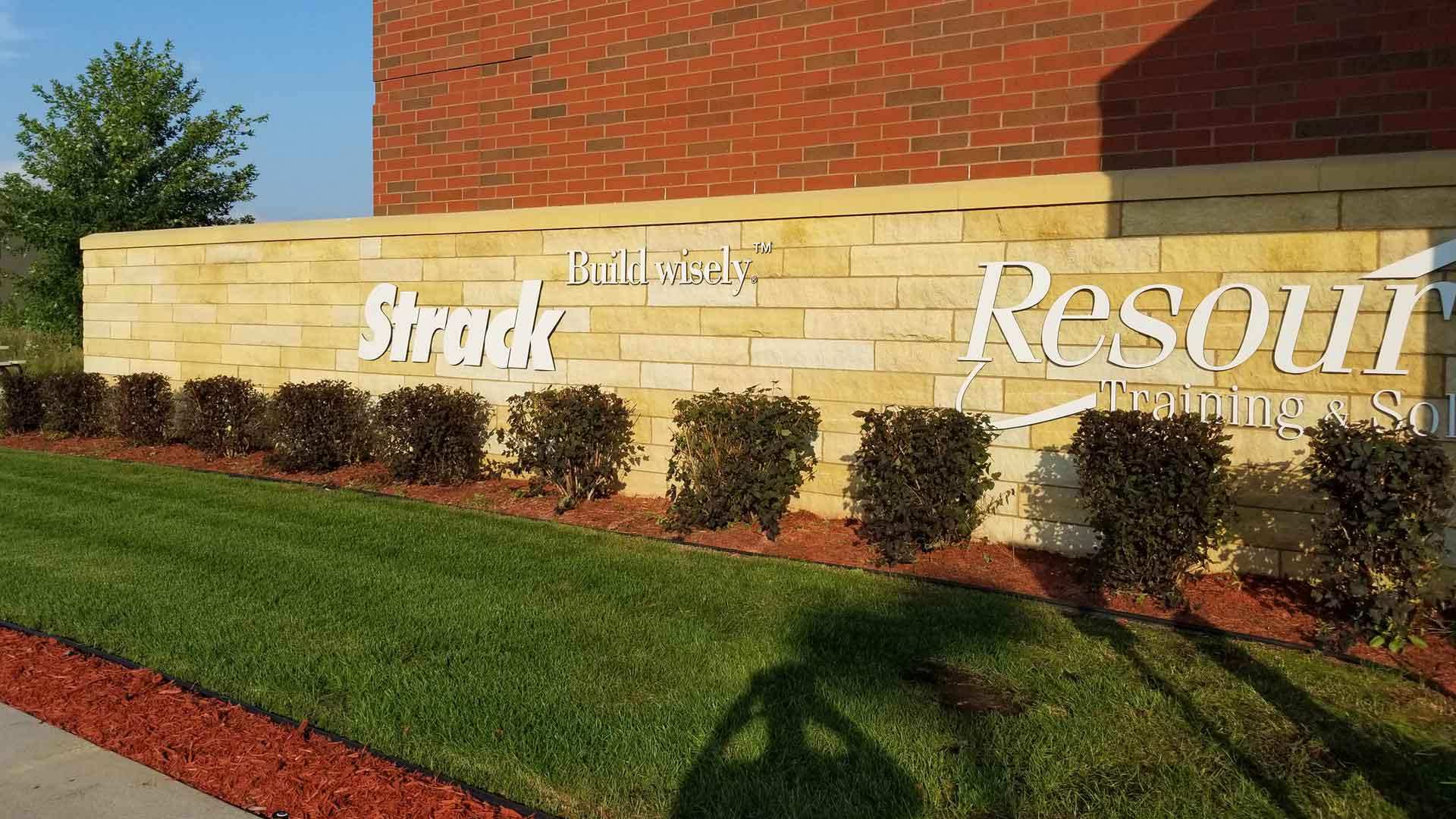 Perfectly trimmed shrubs in front of a commercial building in Sauk Rapids.