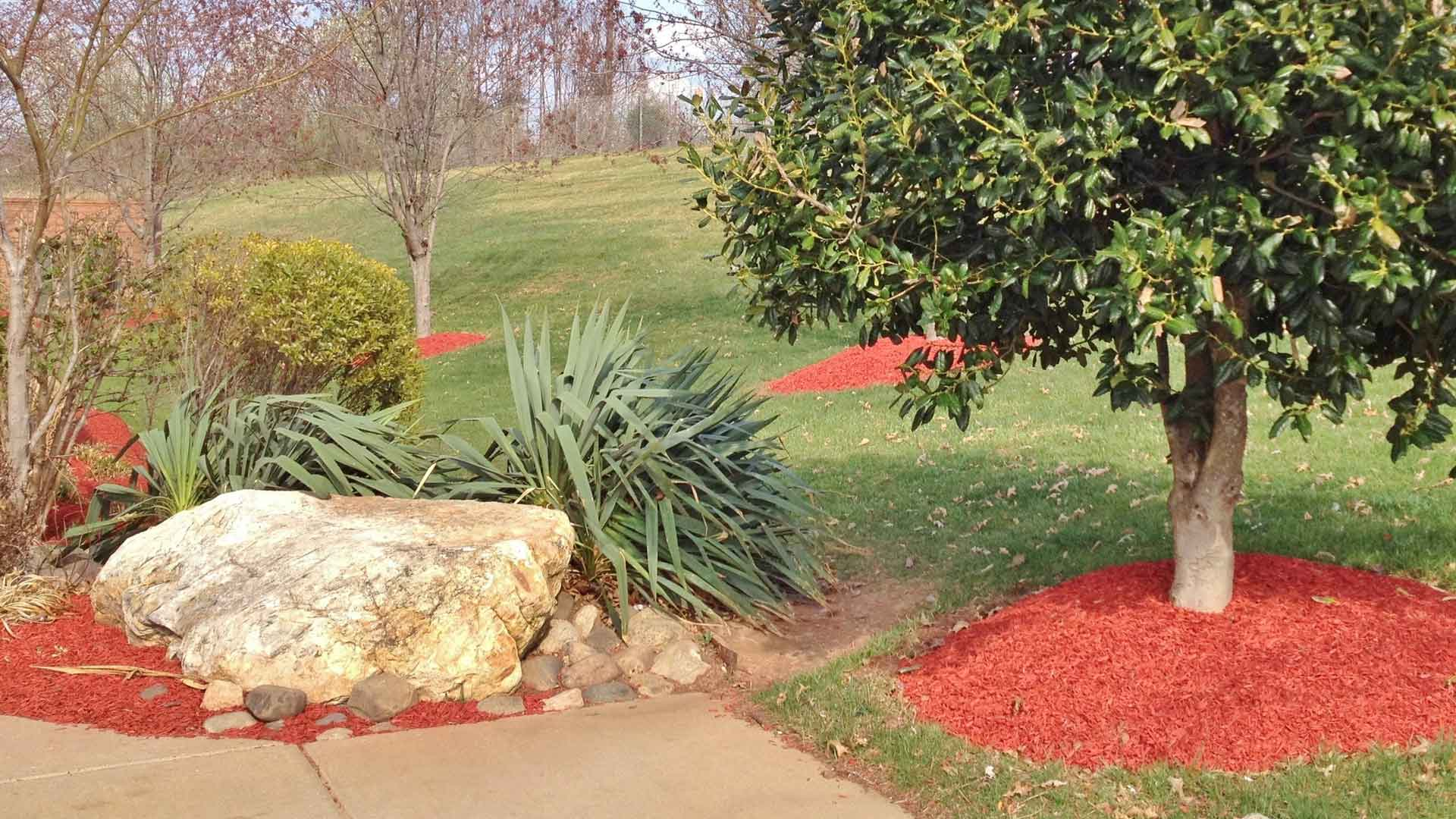 Red mulch installed in landscaping beds at a home in Sartell.