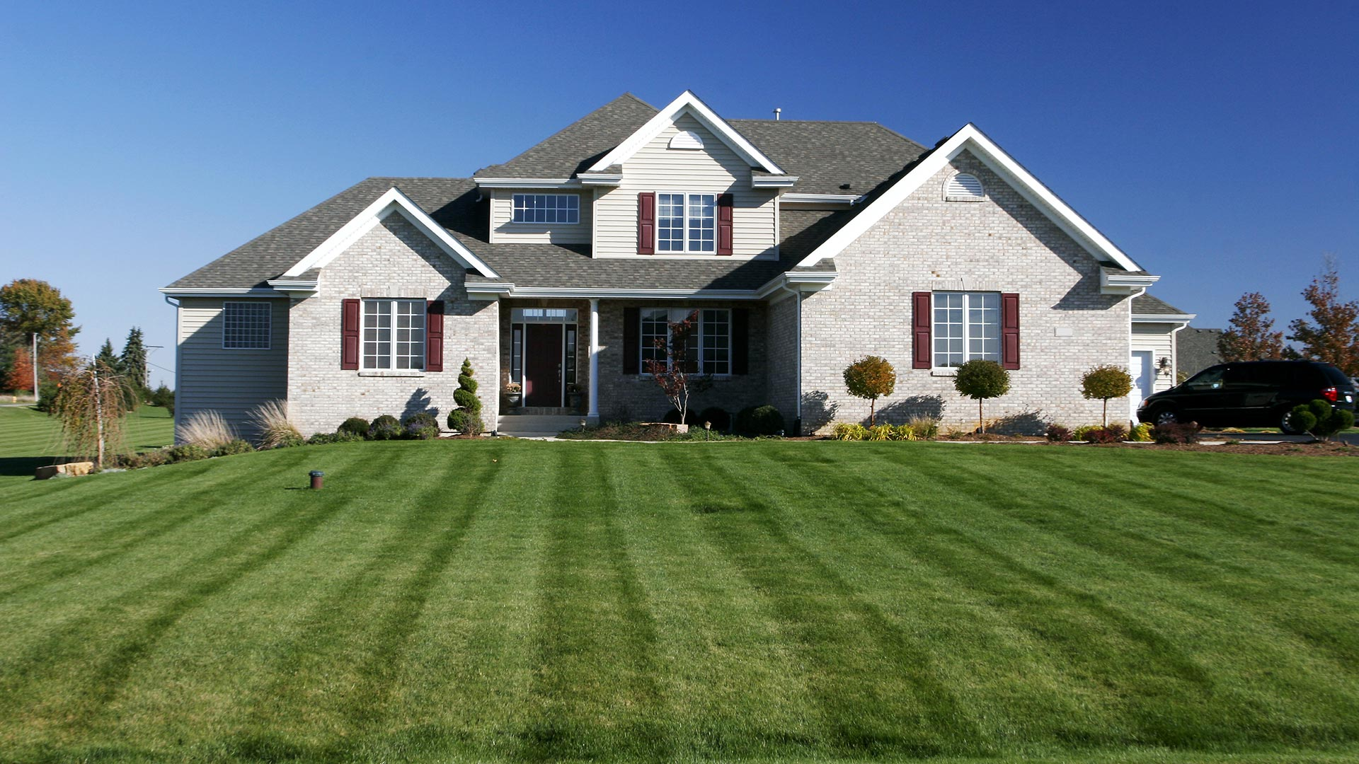 Residential lawn with regular lawn mowing services in Sartell, MN.