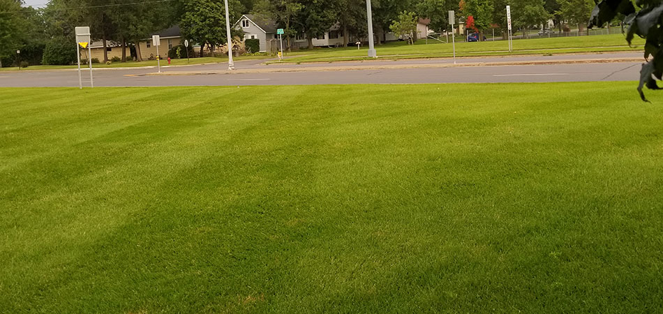 Mowing a commercial property next to a busy road in St. Cloud.