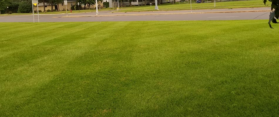 Commercial property in Sauk Rapids, MN with routine mowing services.