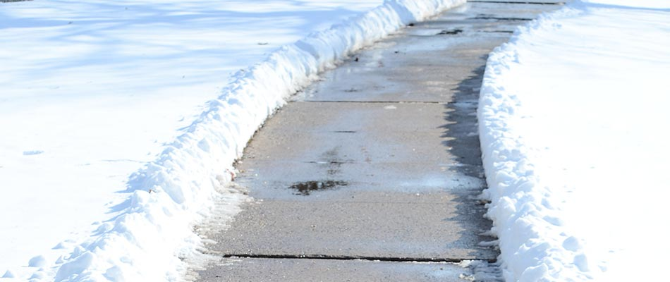 Clearing snow from sidewalks in St. Cloud, MN helps reduce ice-related injuries.